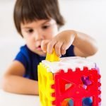 Child psychology, preschooler doing test with didactic cube