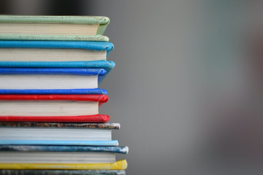 A stack of books neatly placed on a table