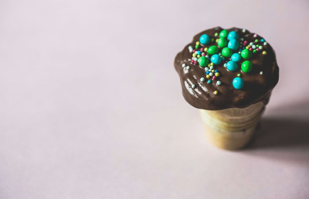 A cupcake with chocolate frosting - to illustrate obesity and unhealthy eating habits