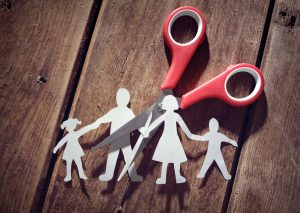Paper cut out of a family going through a divorce